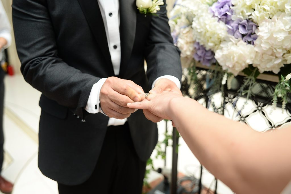 Groom Placing Ring